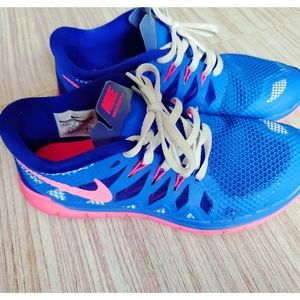Nike 4.5Y blue and pink running shoes